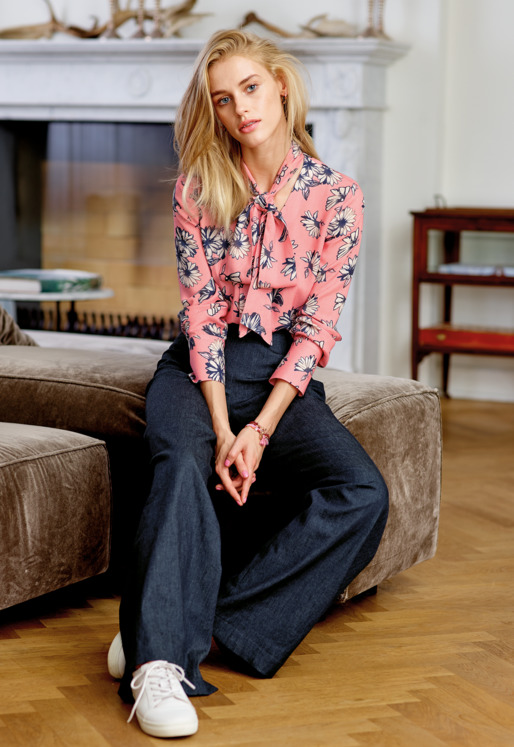 Blouse and denim trousers